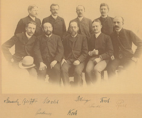 Robert Koch and his students, 1885: (from the left) von Esmarch, Pfeiffer, Nocht, Koch, Behring, Fraenkel, Frosch, Pfuhl. Source: RKI